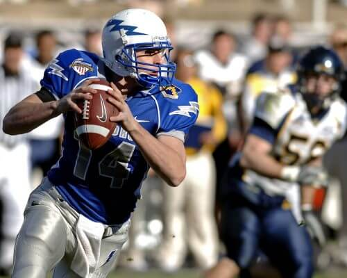 american footballer holding the ball mid game who believes in medical cannabis for athletes