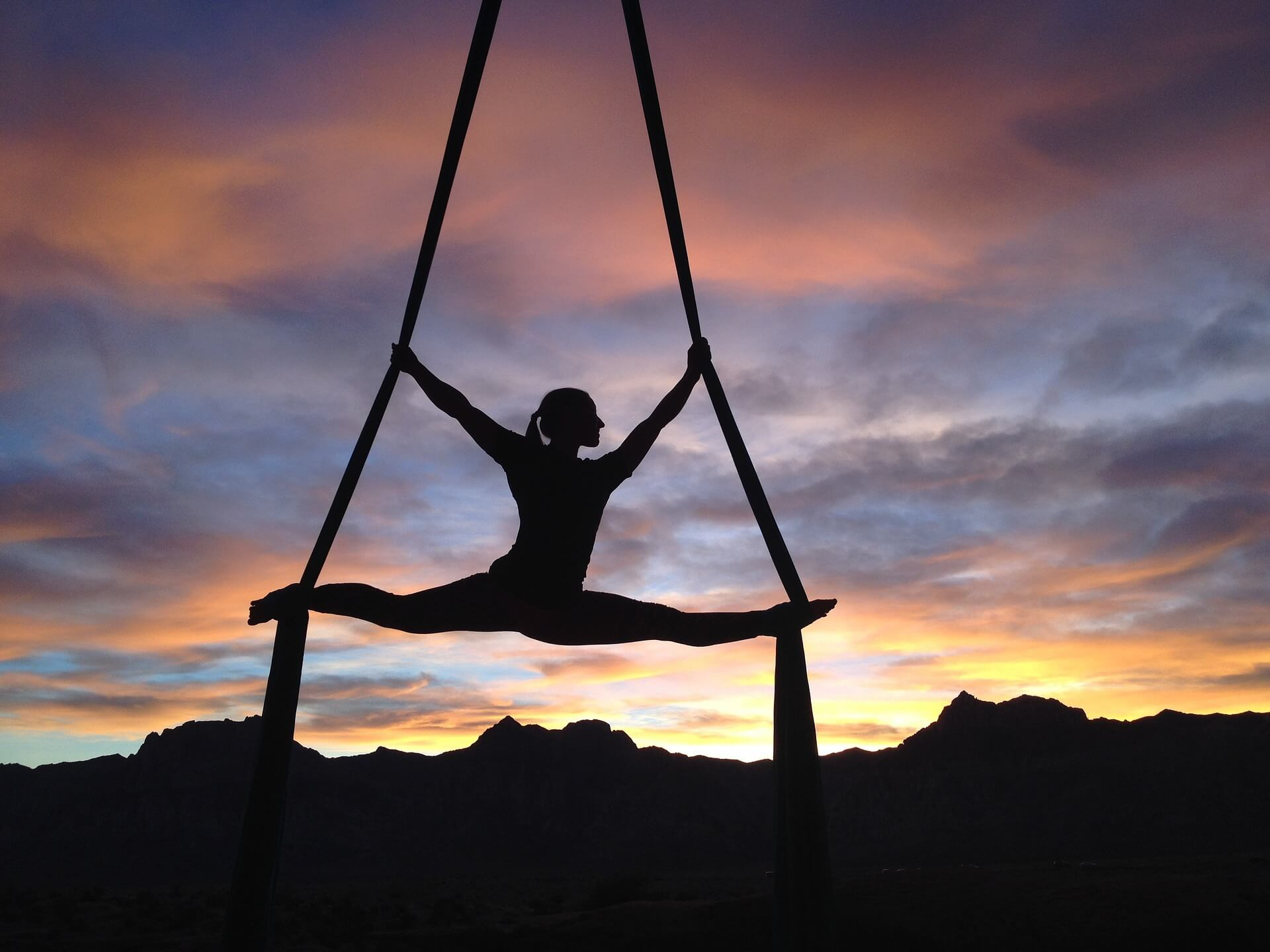 professional gymnast woman shadowed by sunset using CBD for sports