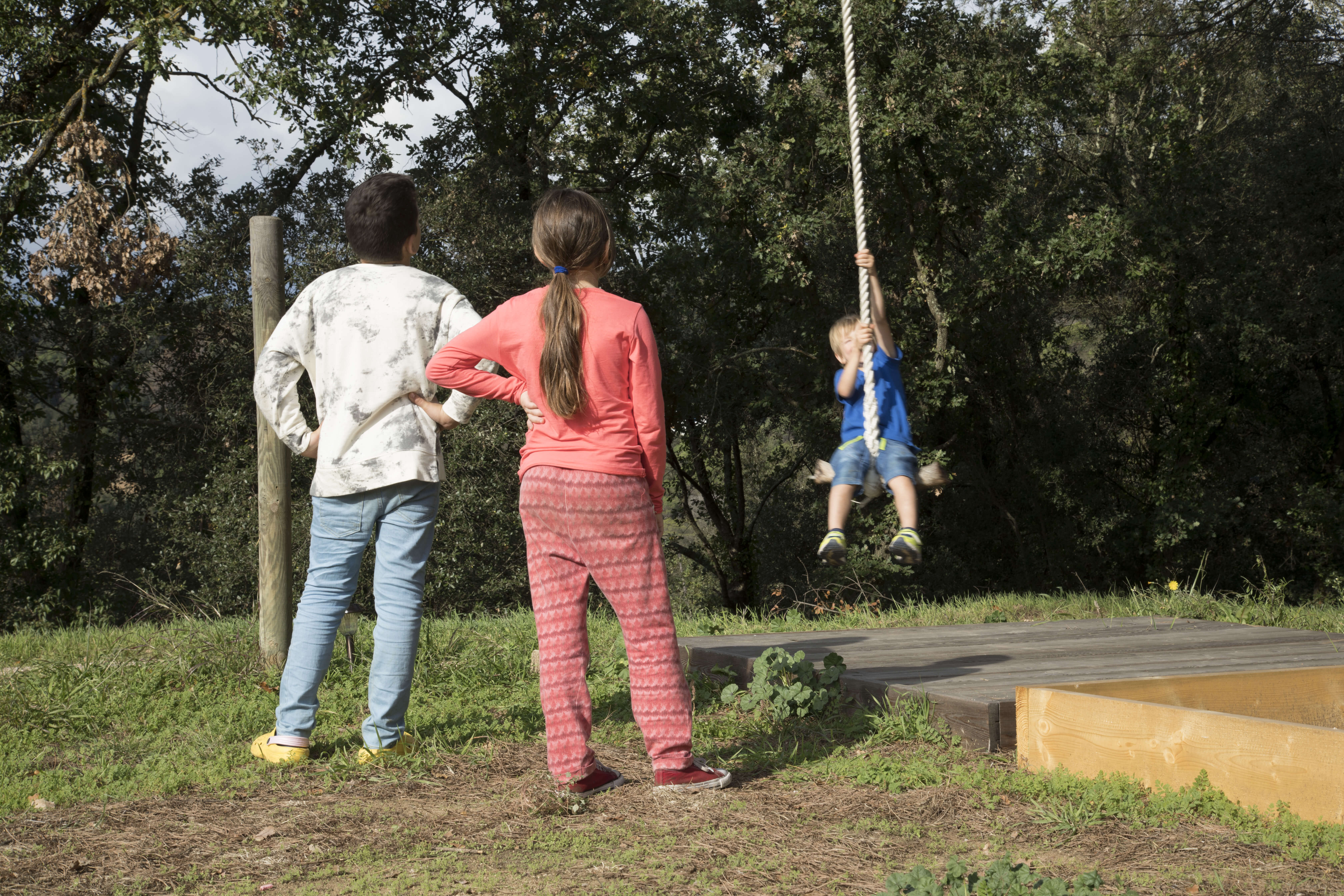 kids who might need to use medical cannabis at school playing on swing