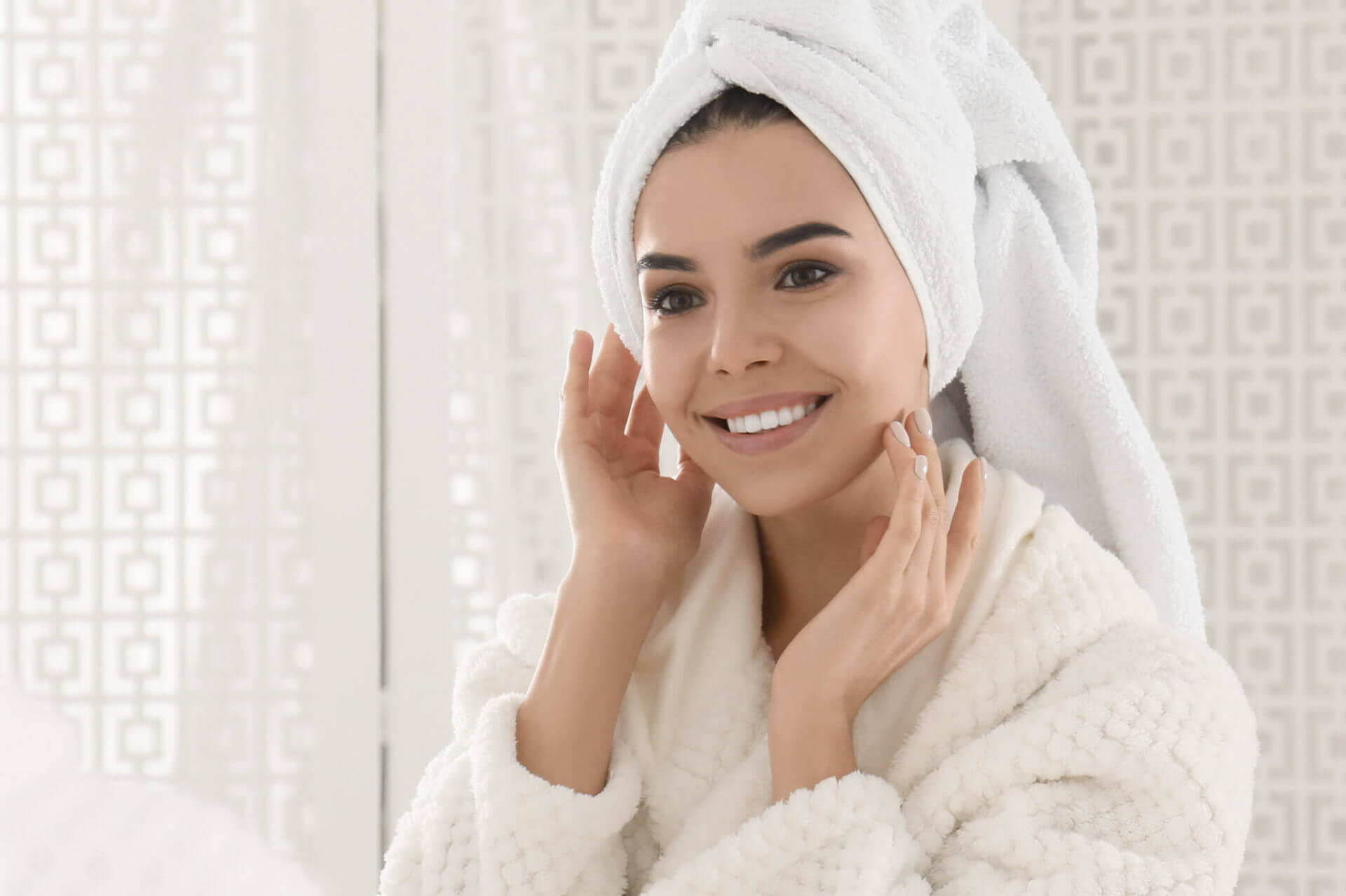 Woman using CBD skincare