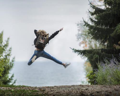 happy-woman-in-woods