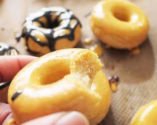 hand holding Pumpkin CBD donuts