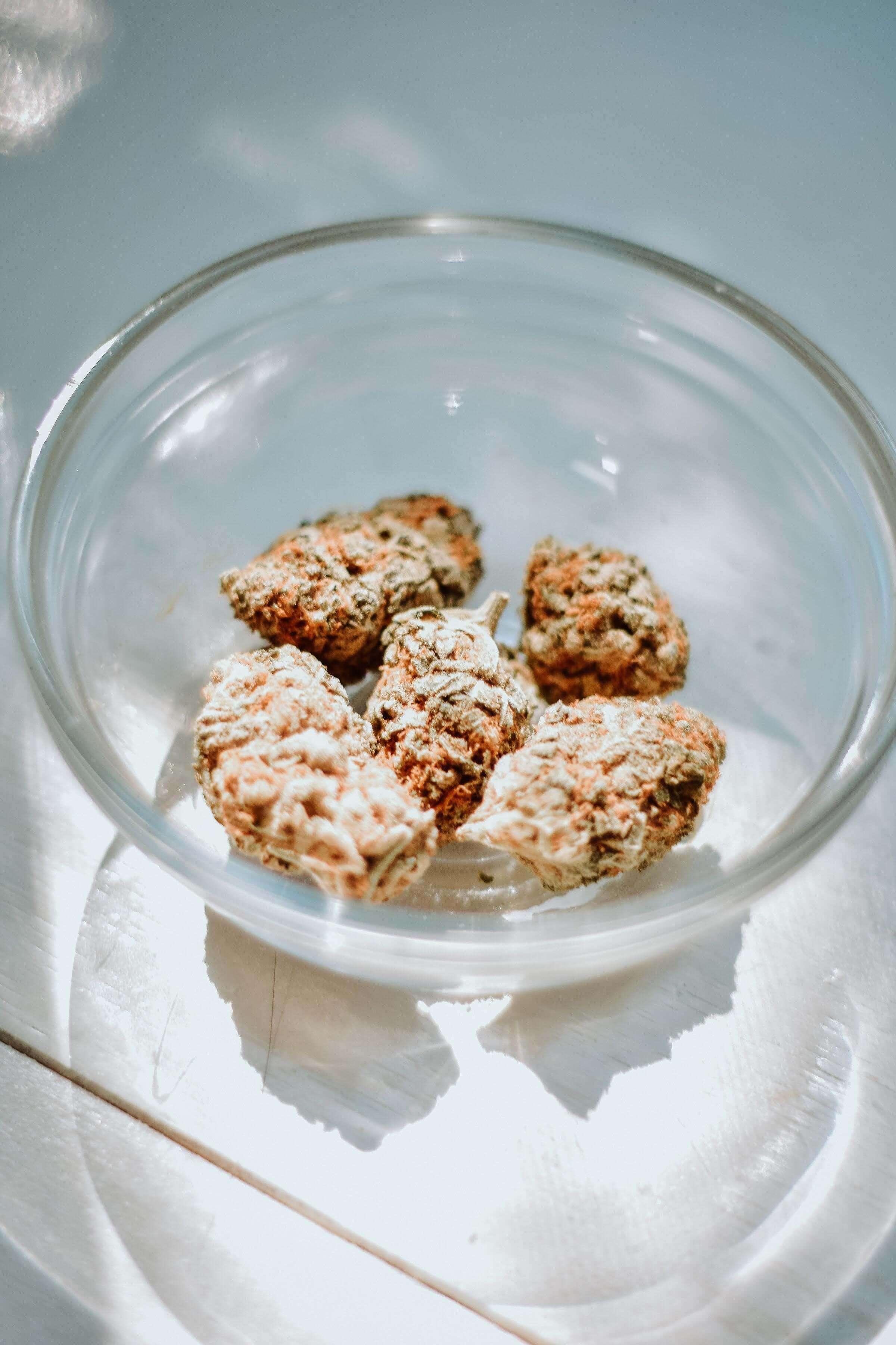 cannabis buds ina glass bowl