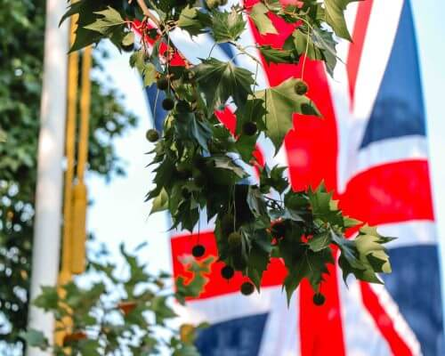 UK flag hanging with trees