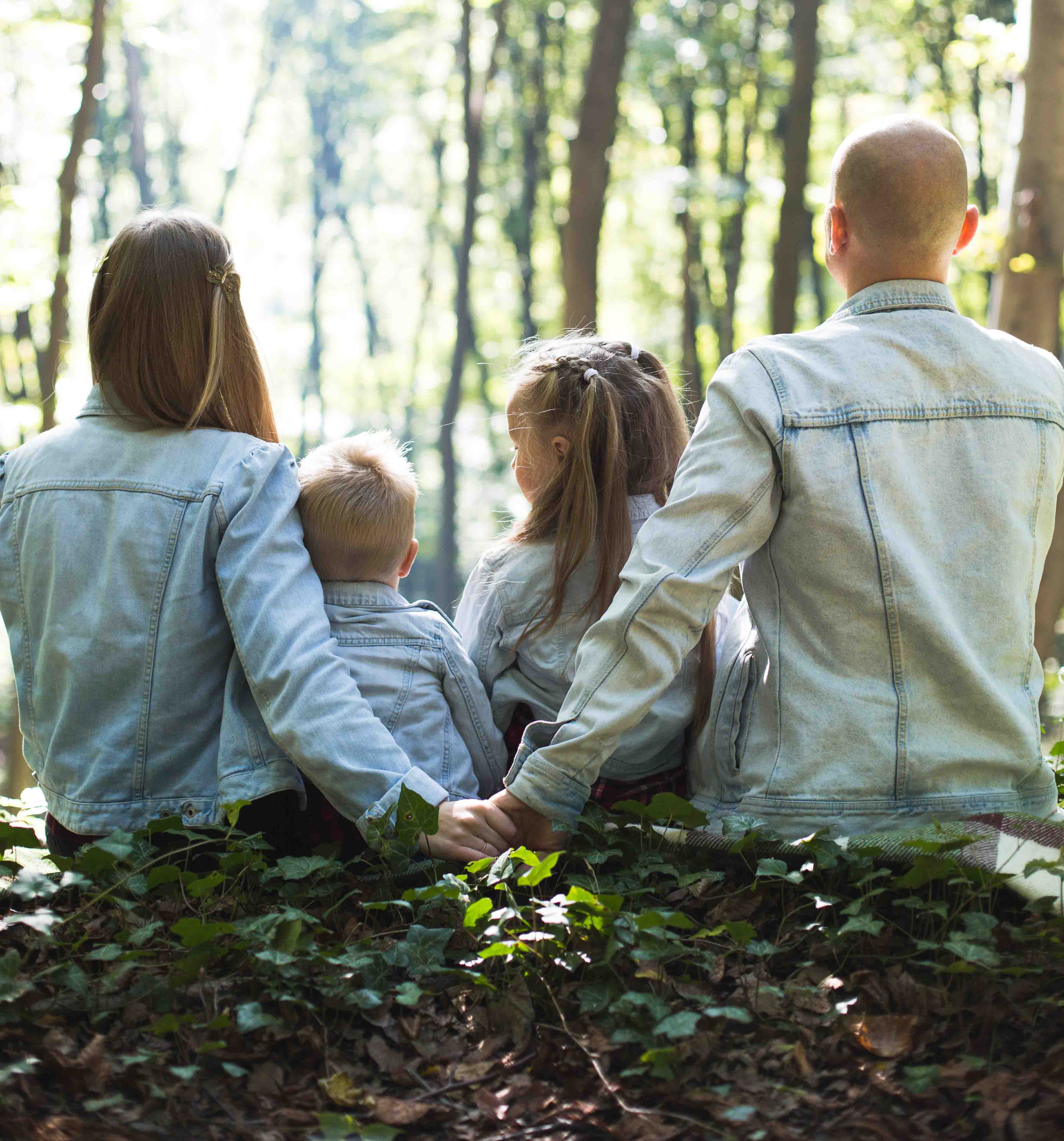 Family sitting in a forest