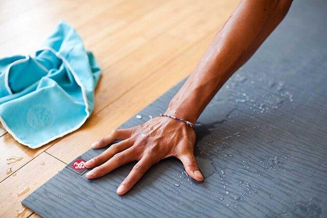 Hand on yoga mat