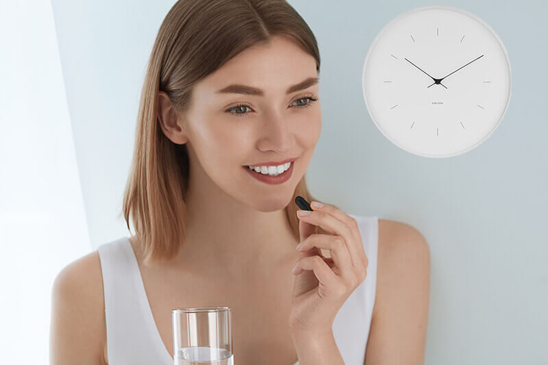 What is the best time to take CBD-woman taking a CBD capsule