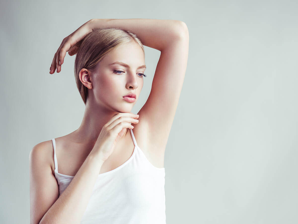 CBD deodorant-woman thinking about armpits.