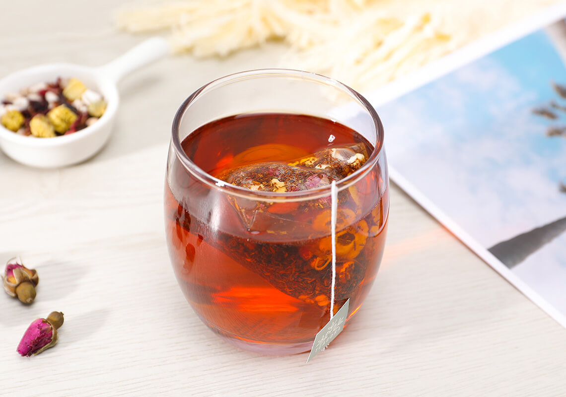 cup of tea with tea bag in glass cup