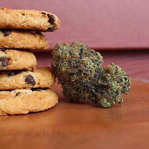 stack of cookies next to hemp bud