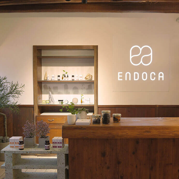 Wooden counter of CBD store with several CBD products