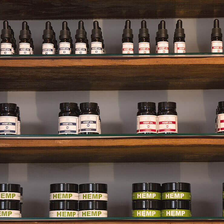 Display of CBD and hemp products on wooden shelves